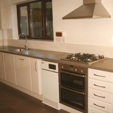 High Gloss Ivory KItchen in Dronfield S18 with a corian worktop