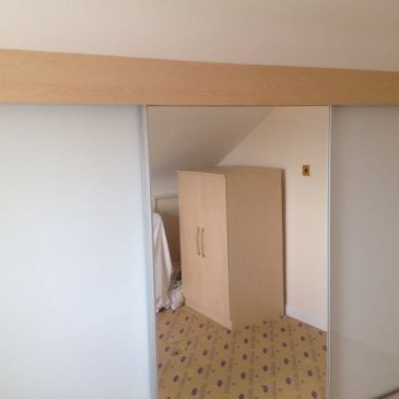 loft conversion: Sliding wardrobe pure white and silver mirror. Chesterfield S41